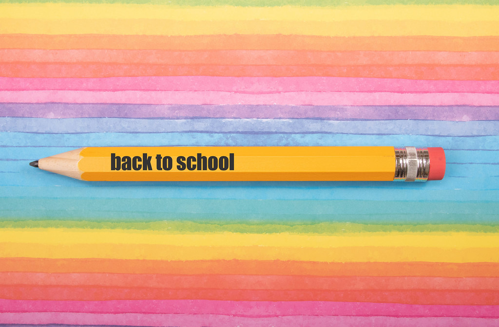 Pen with Back to School text on colorful background