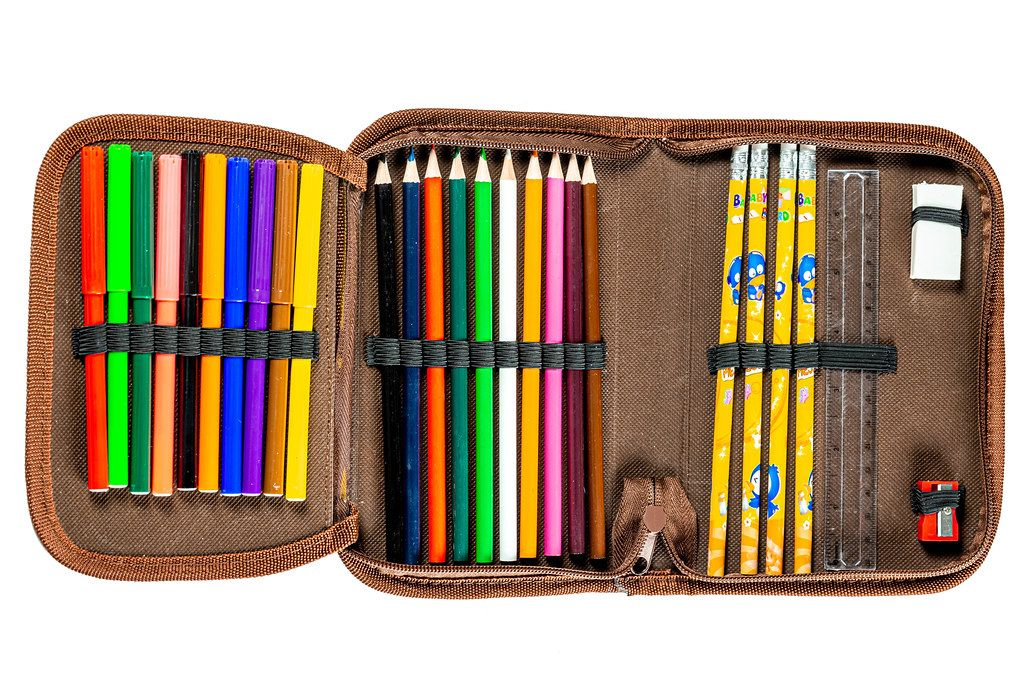 Pencil case full of colored pencils, markers, ruler, eraser and sharpener