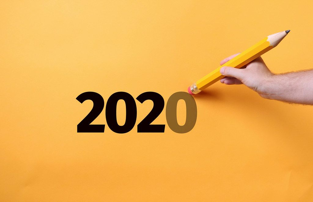 Pencil erasing zero from 2020 text