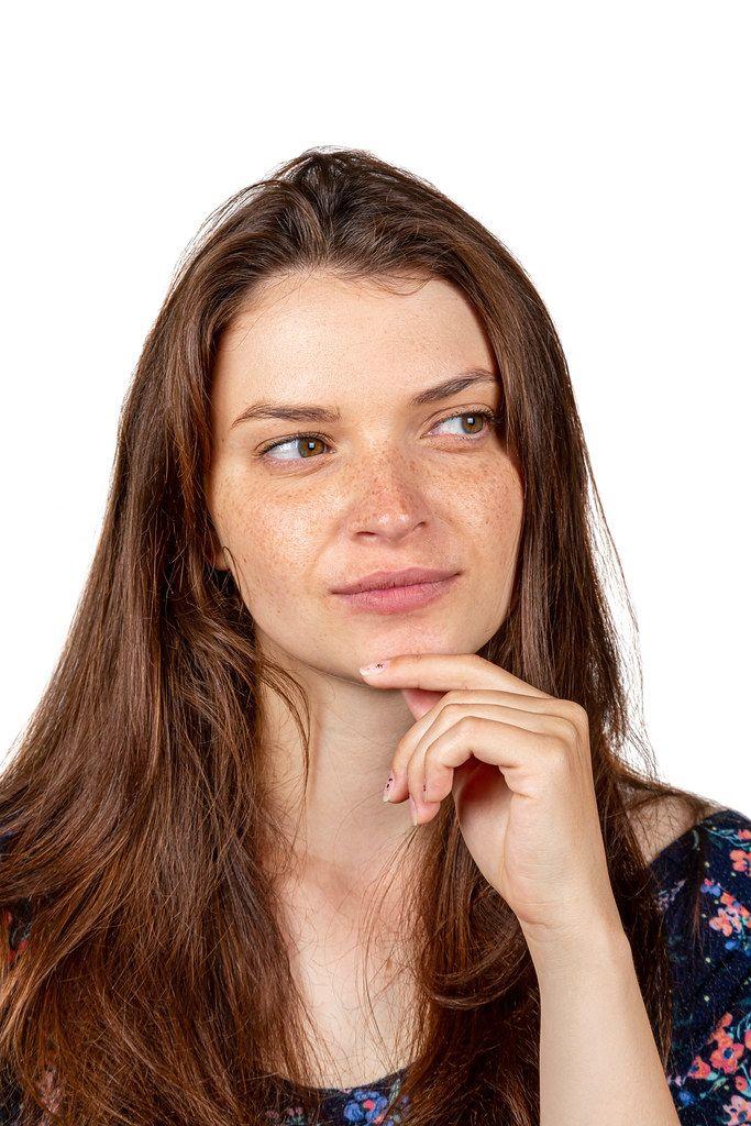 Pensive face of a brunette girl
