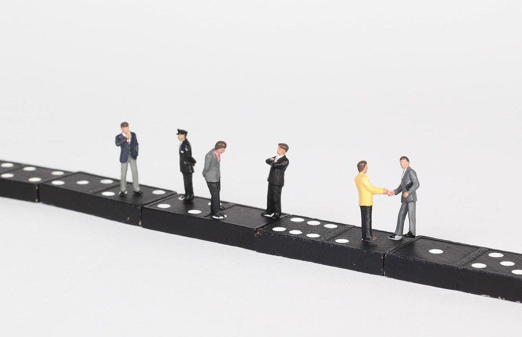 People standing and talking on dominoes