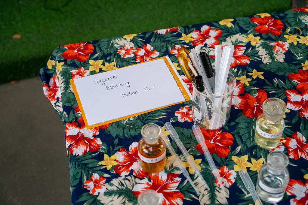 Perfume Blending Station Signboard on a Table with different Scents, Pipettes and other Equipment at a Weekend Market