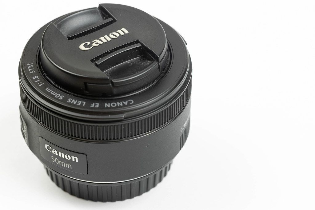 Photographic Canon Prime Lens 50mm f1.8 isolated above white background