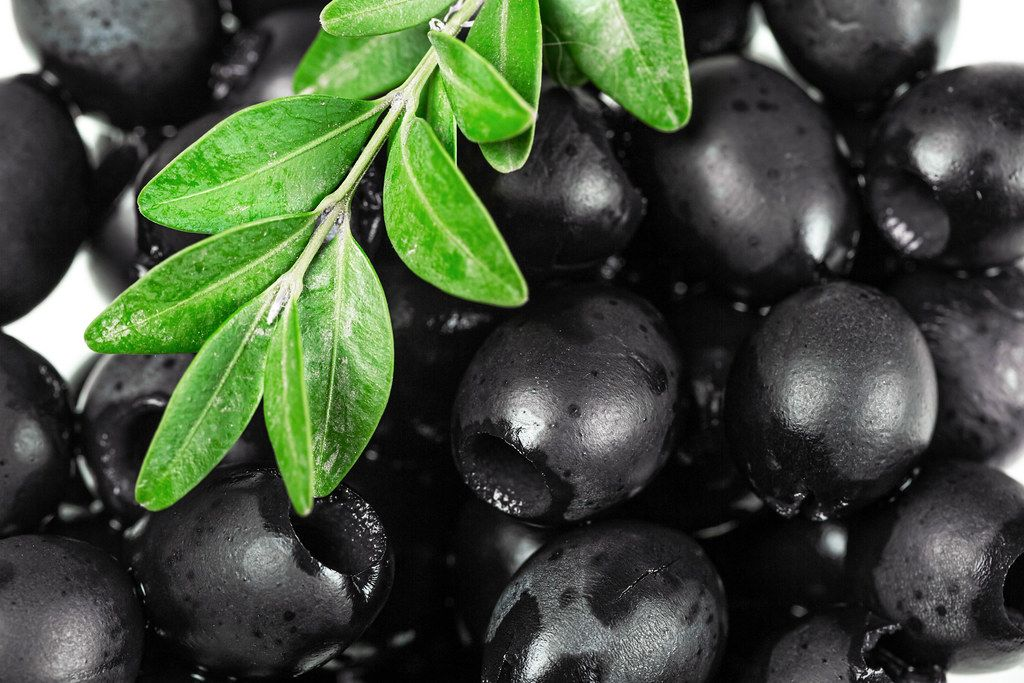 Pickled black pitted olives background