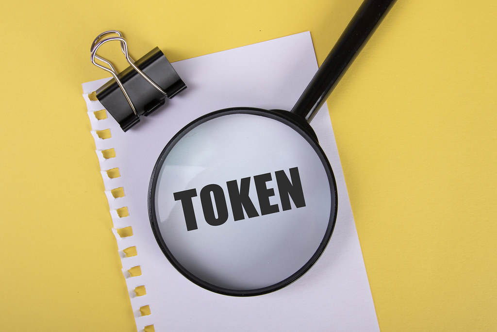 Piece of paper with Token text and magnifying glass