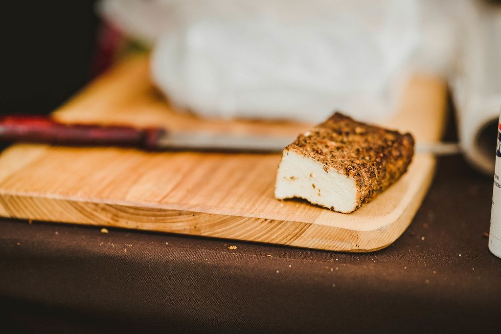 Piece Of Smoked Cheese On Wooden Plate