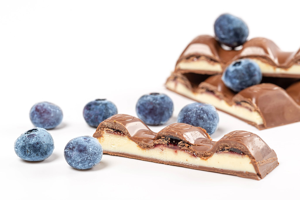 Pieces of chocolate with milk filling and blueberries