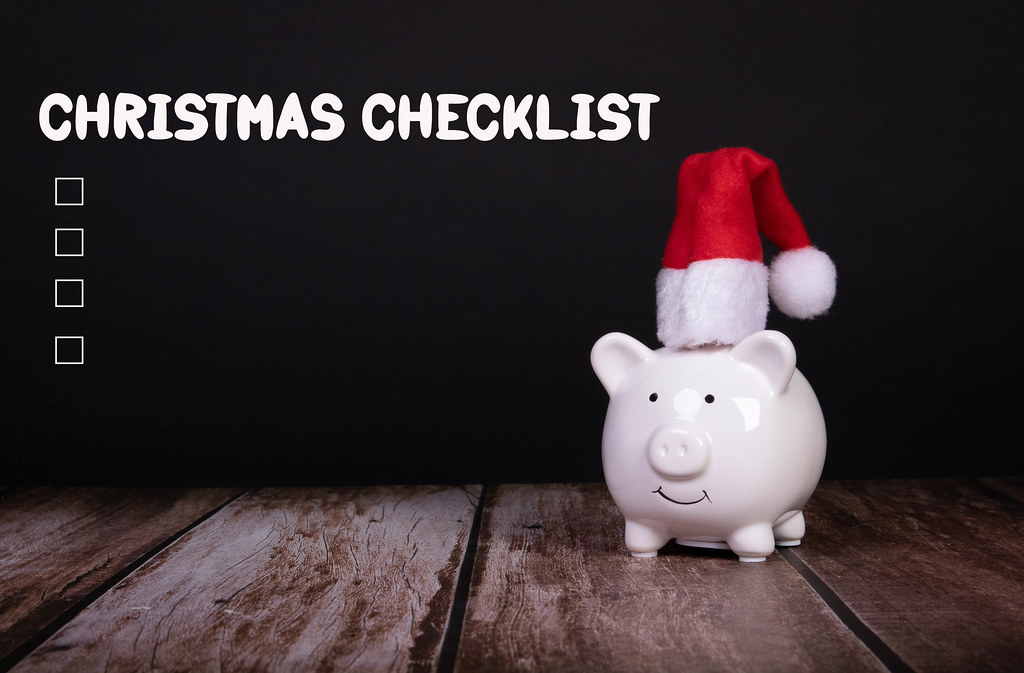 Piggy bank with Christmas hat and Chirstmas Checklist text