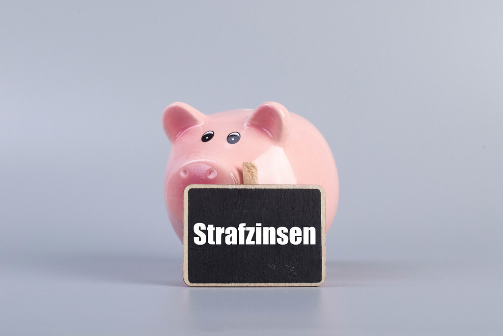 Piggybank with Strafzinsen text