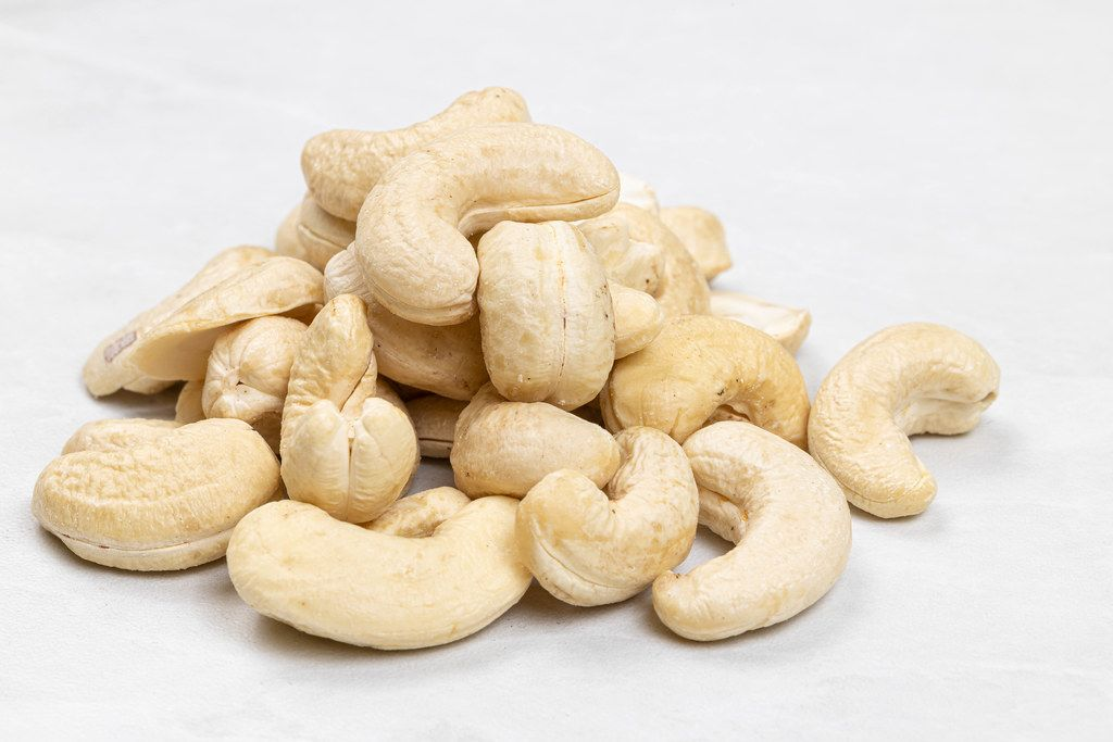 Pile of Cashew nuts on the grey marble table