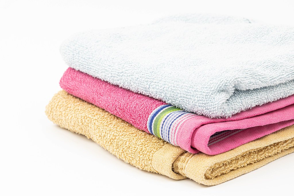 Pile of clean Towels isolated above white background