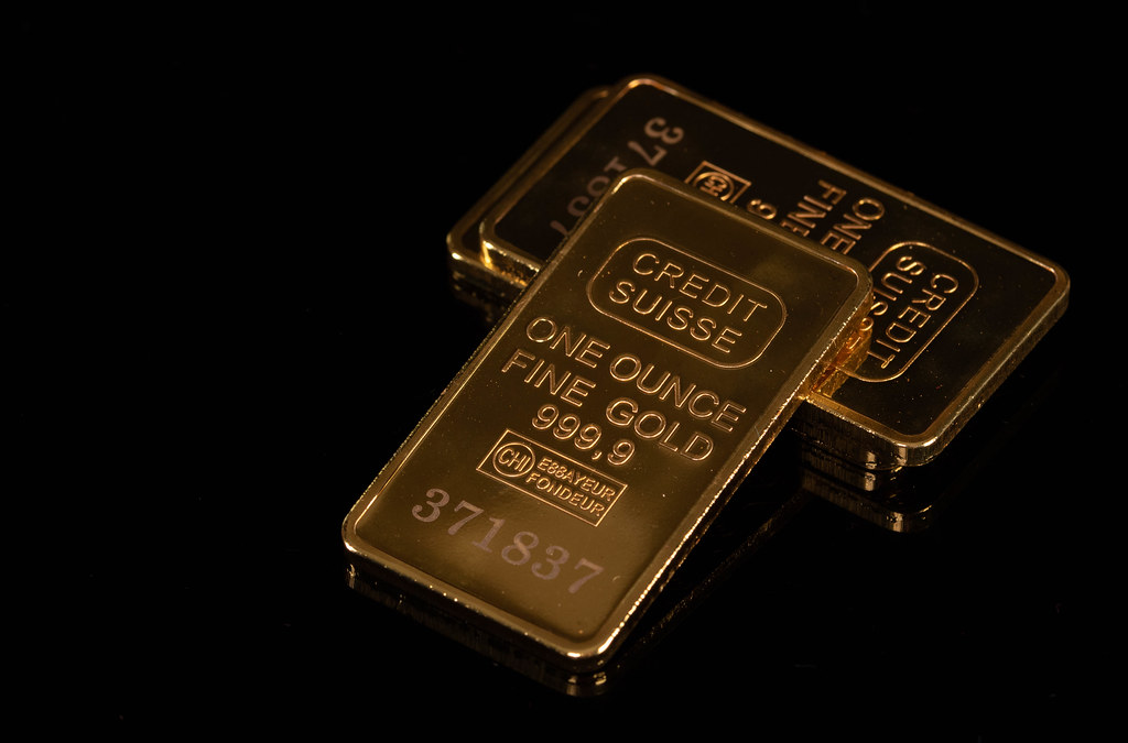 Pile of gold bars on black background