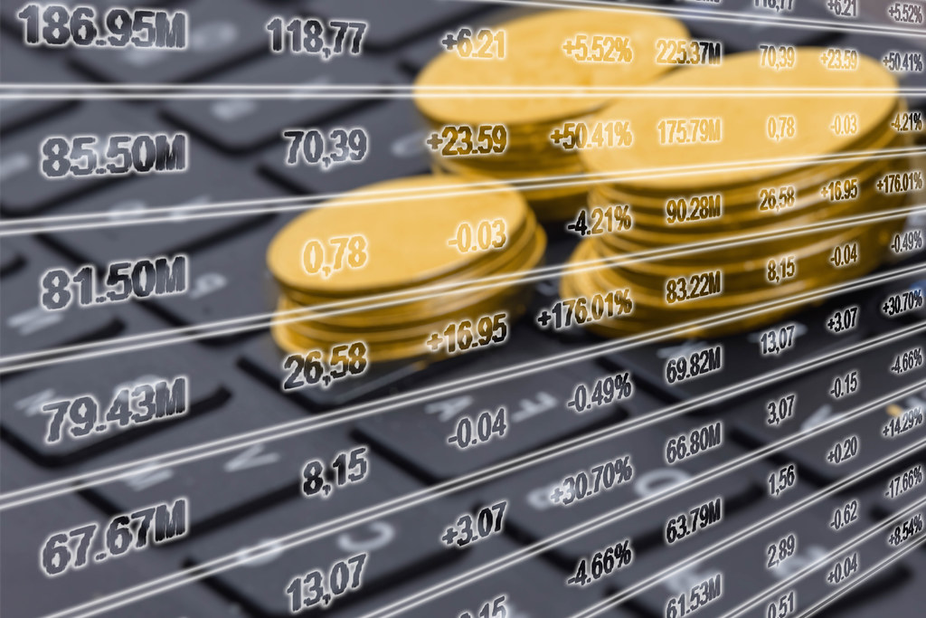 Pile of golden coins on the computer keyboard - Concept of blockchain and cryptocurrencies