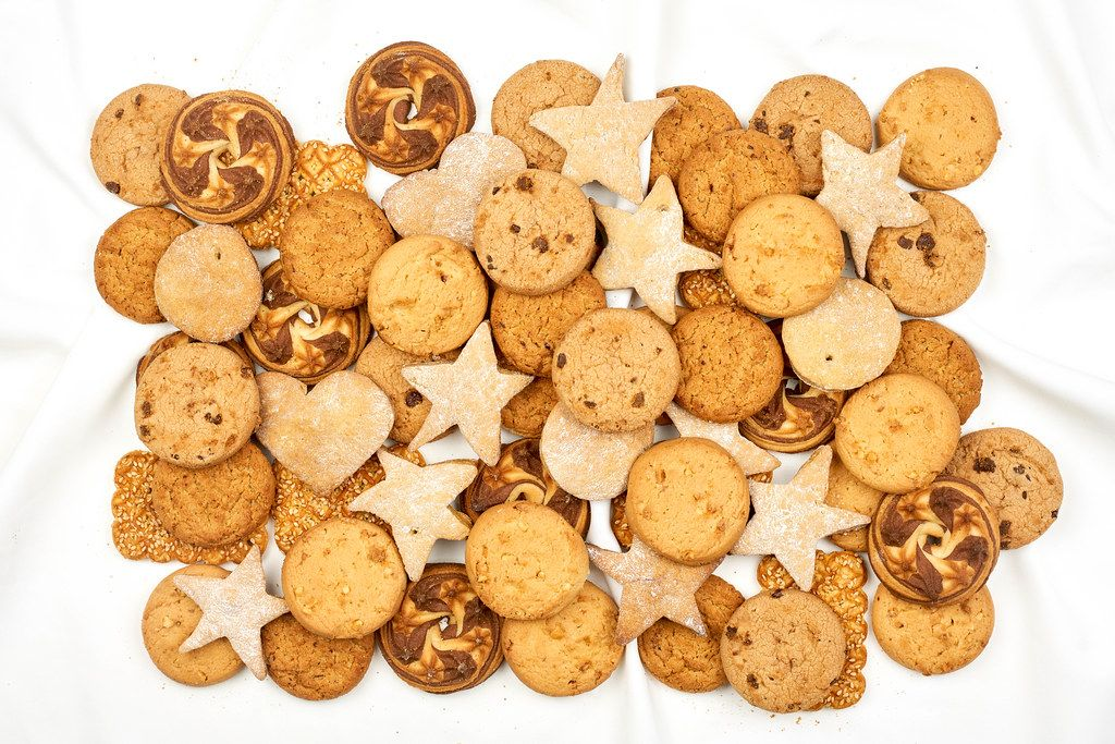 Pile of sweet cookies on white background