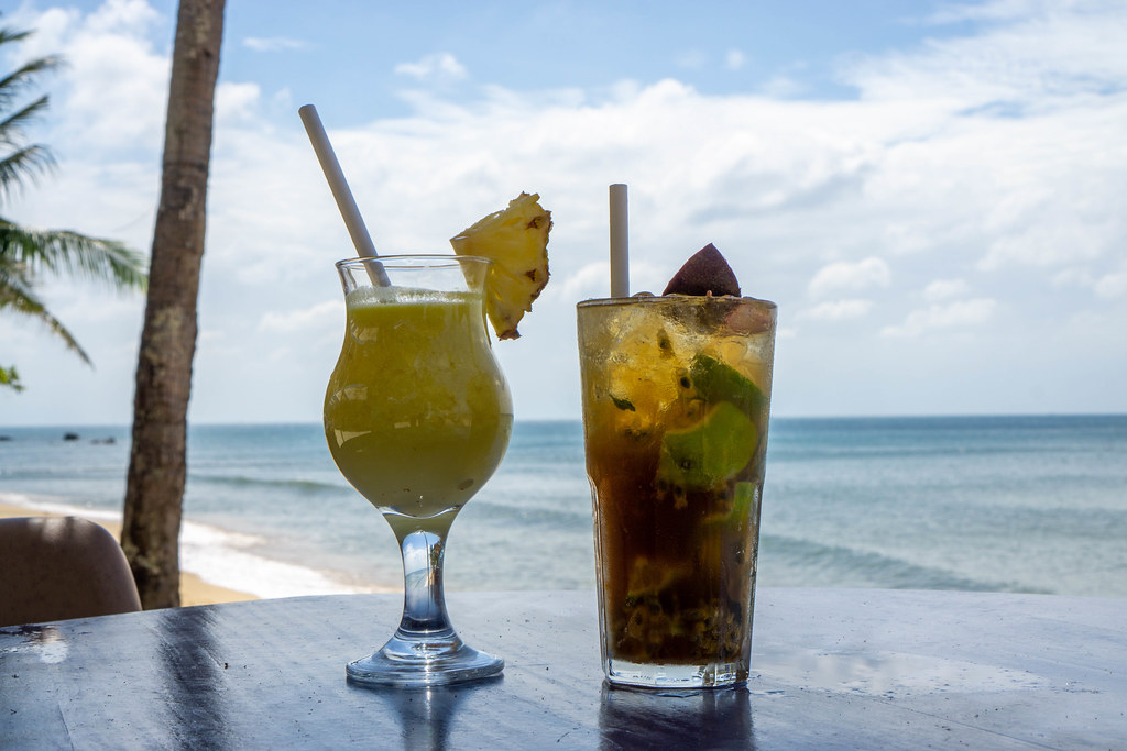 Pina Colada with Fresh Pineapple and Passion Fruit Mojito with Mint, Lime and Ice Cubes in Cocktail Glasses on a Table at a Beach Bar in Phu Quoc, Vietnam