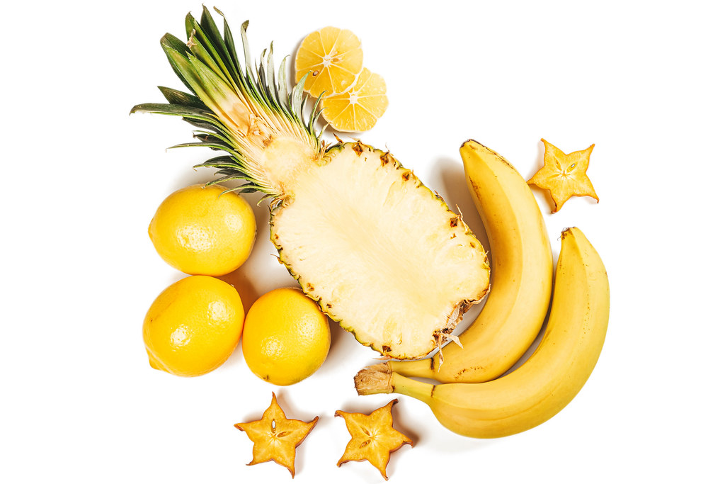 Pineapple with lemons, bananas and slices of caramboli, top view