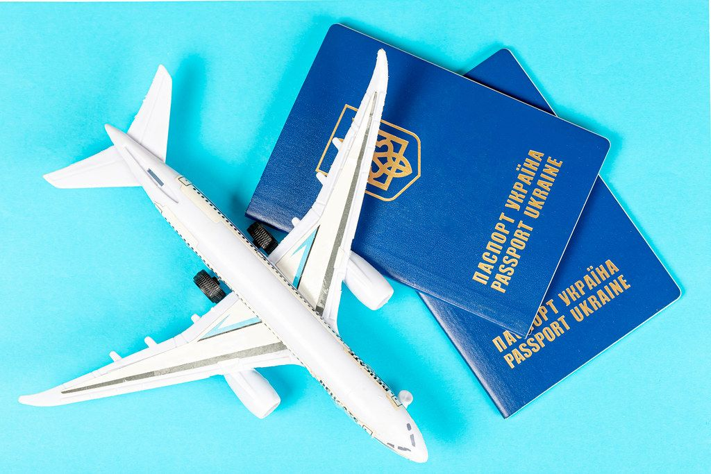 Plane travel concept- passports with plane on blue background