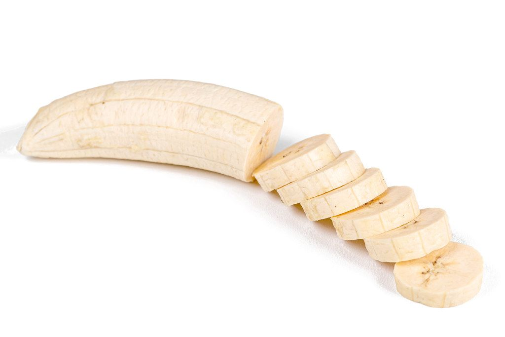 Plantain sliced on a white background