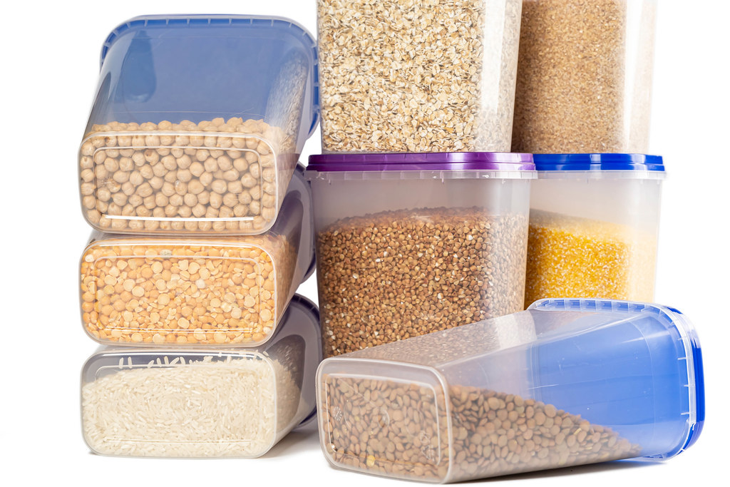 Plastic containers filled with cereals, concept of organization of storage of bulk cereals on the kitchen