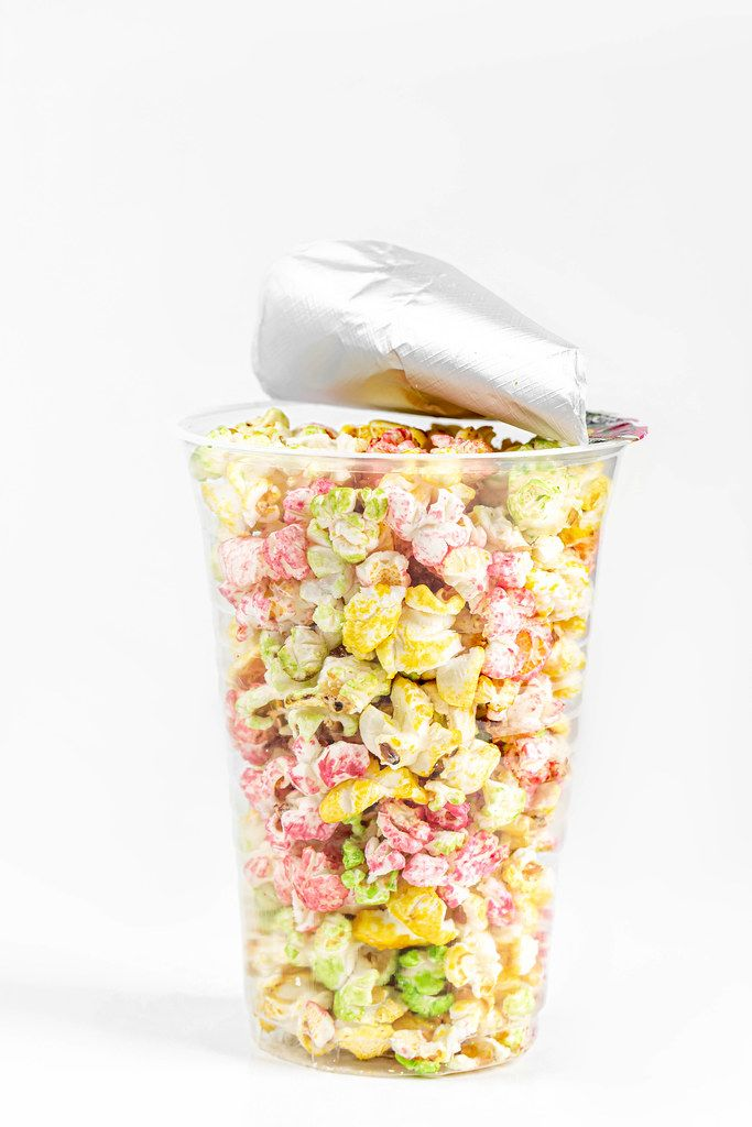 Plastic cup with multi-colored sweet popcorn