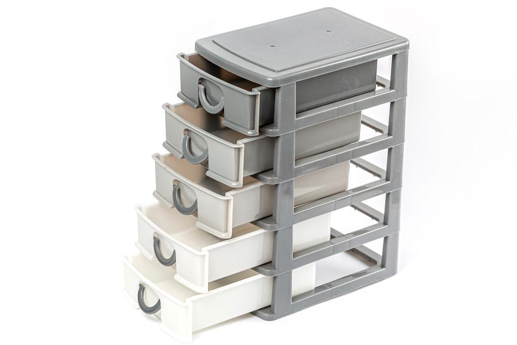 Plastic drawer with open cells on white background
