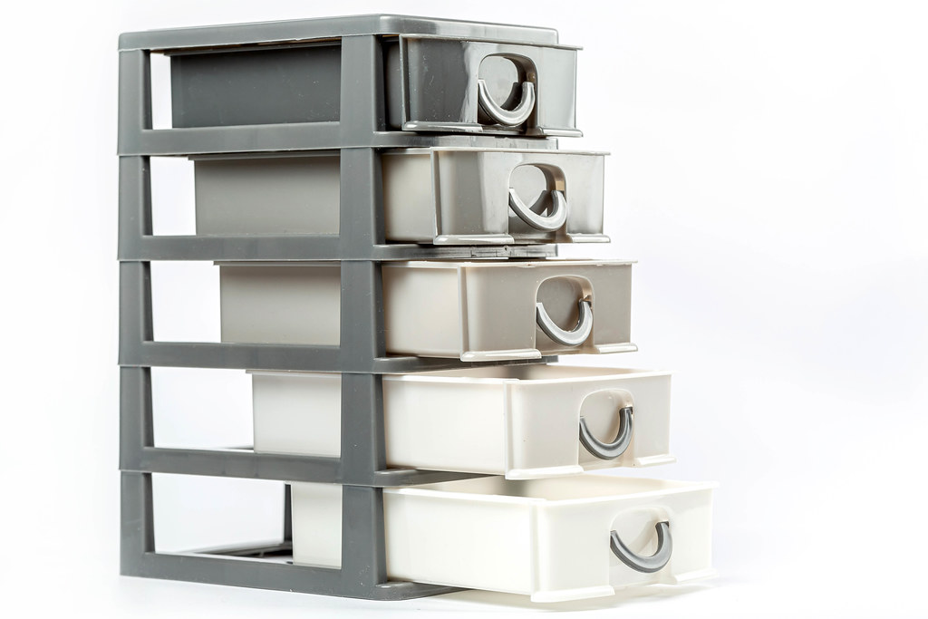 Plastic five drawers container on white background