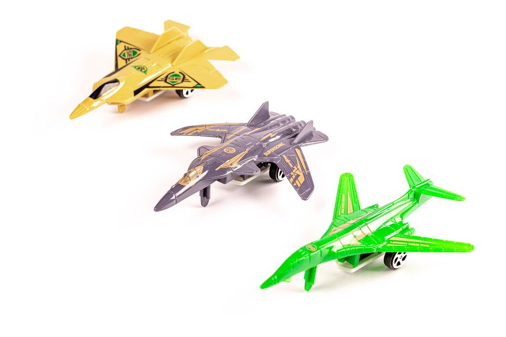 Plastic military aircraft toys on white background