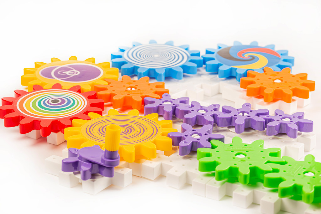 Plastic multi-colored constructor made of gear parts for children