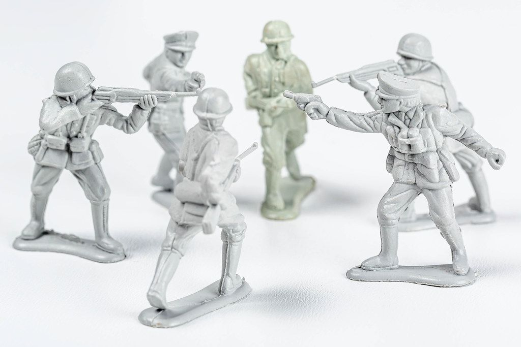 Plastic soldiers with weapons on a white background