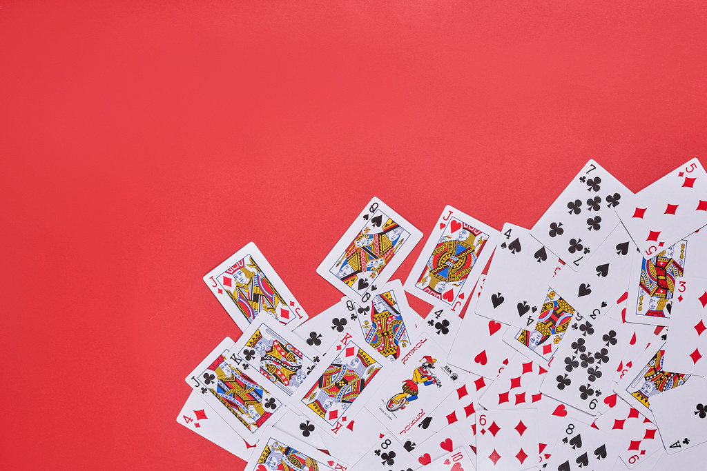 Playing cards on red backdrop