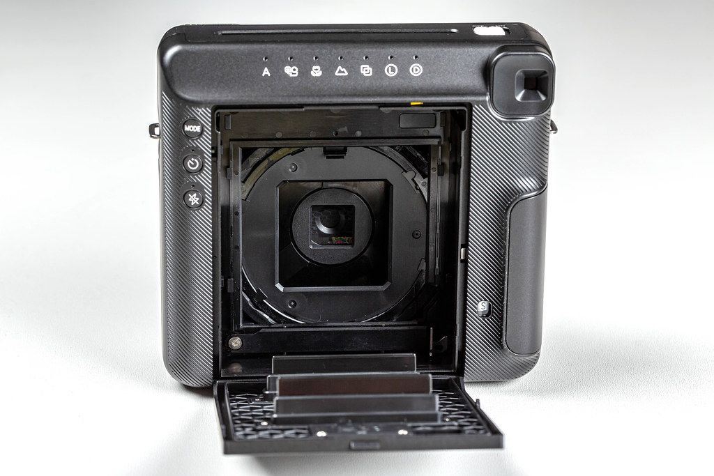 Polaroid camera with open back cover