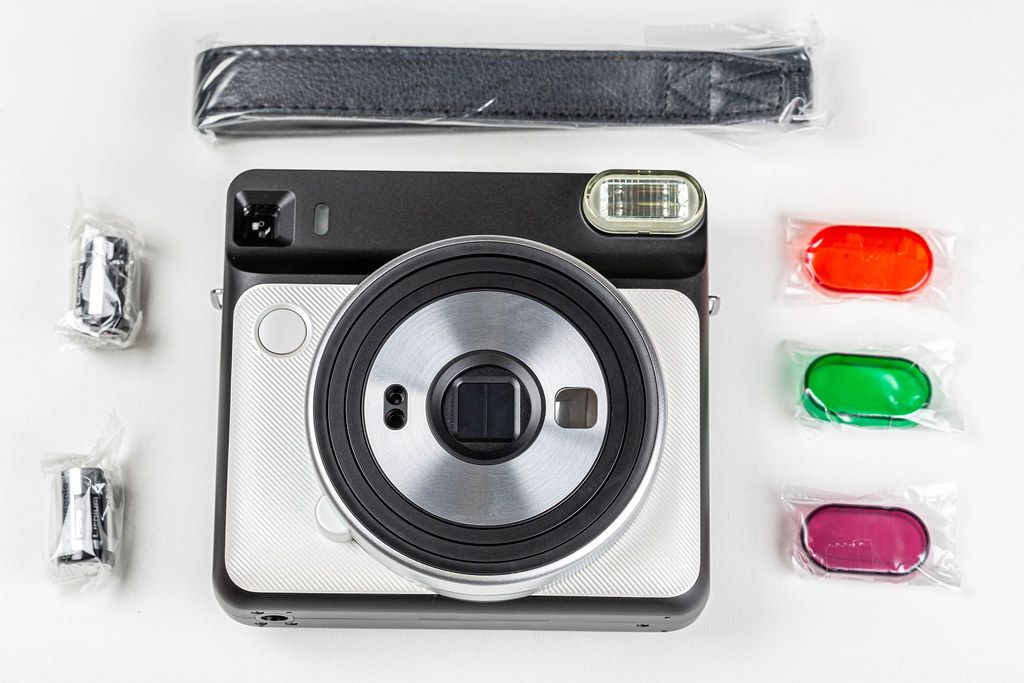 Polaroid with a set of accessories on a white background