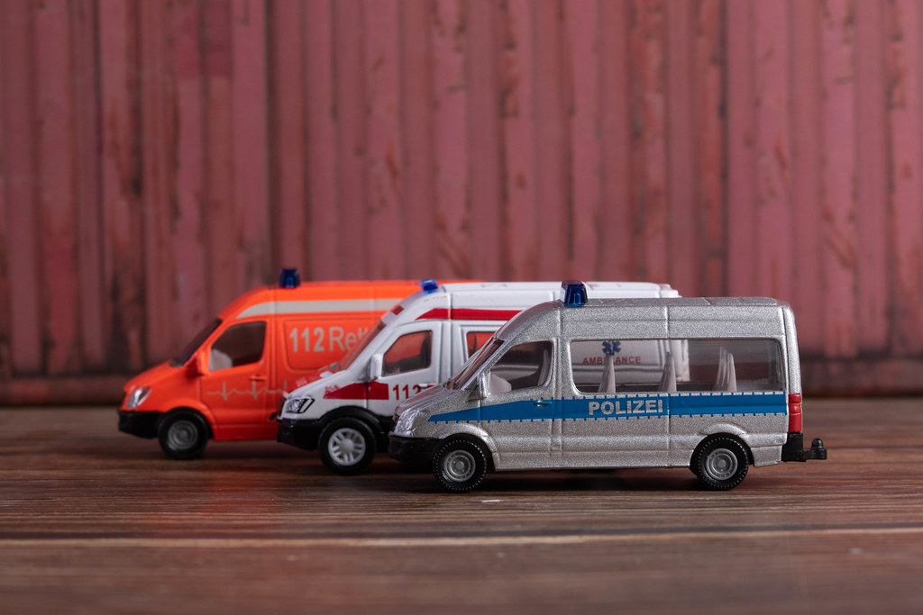 Police, firefighting and ambulance van parked in a line