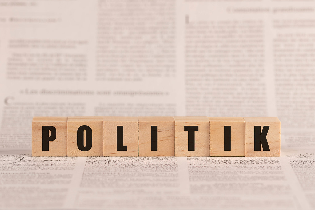 Politik written with cubes on a newspaper