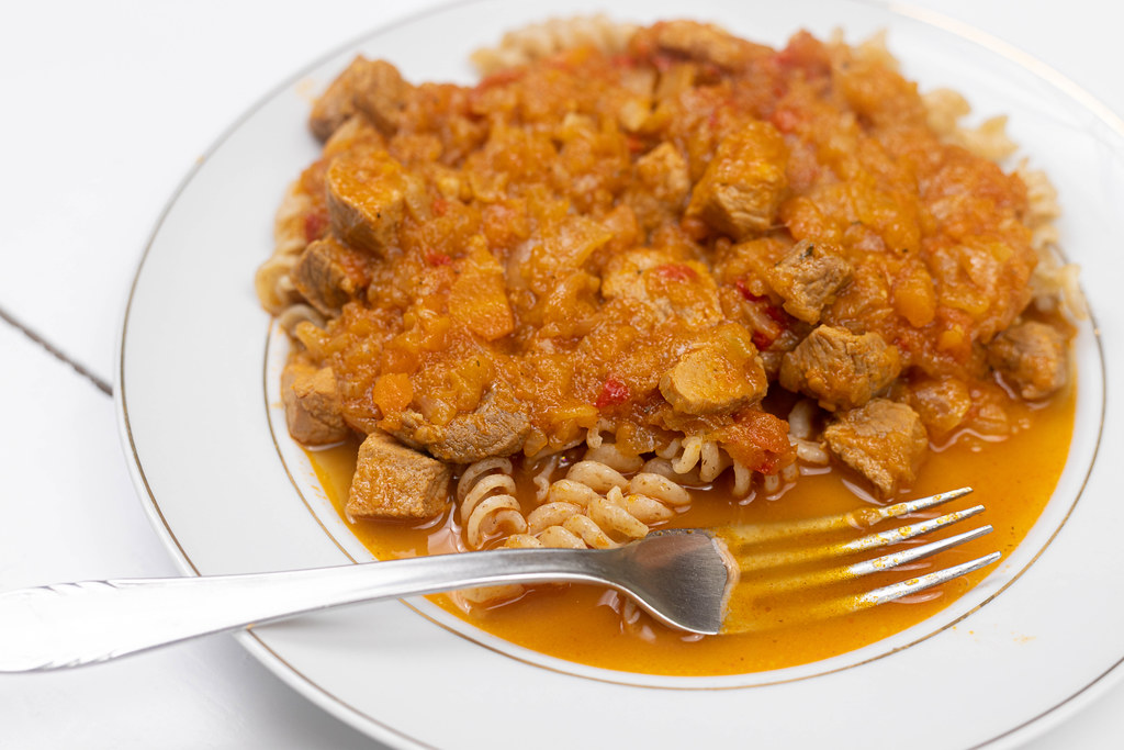 Pork Stew served with cooked macaroni