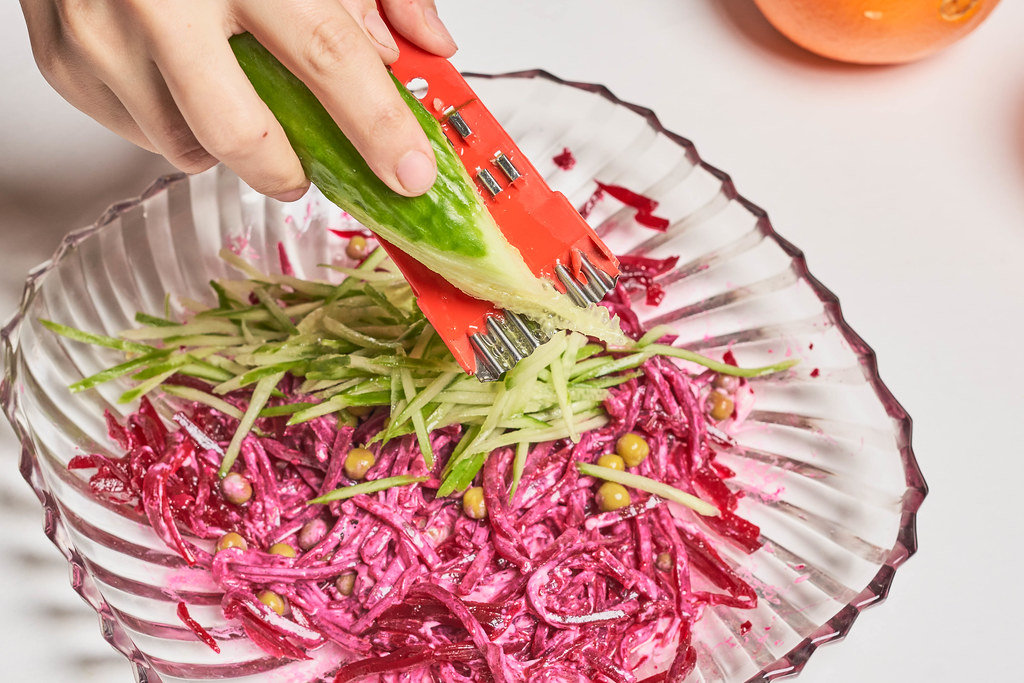 Preparing beet and cucumber based salad