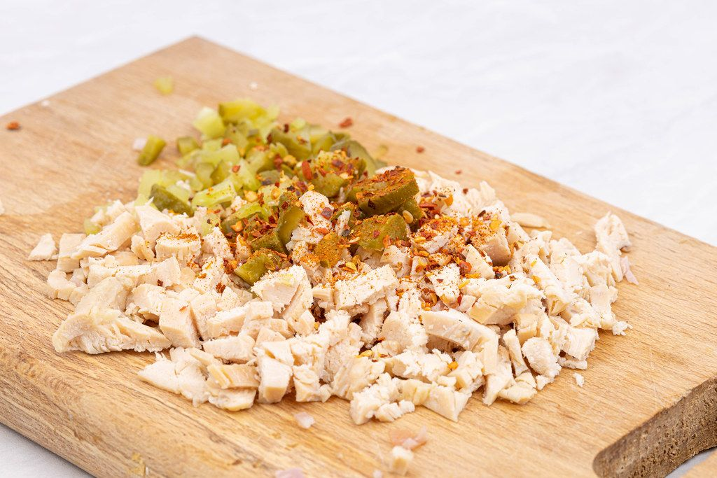 Preparing Chicken Meat salad with Pickles and Spicy Paprika