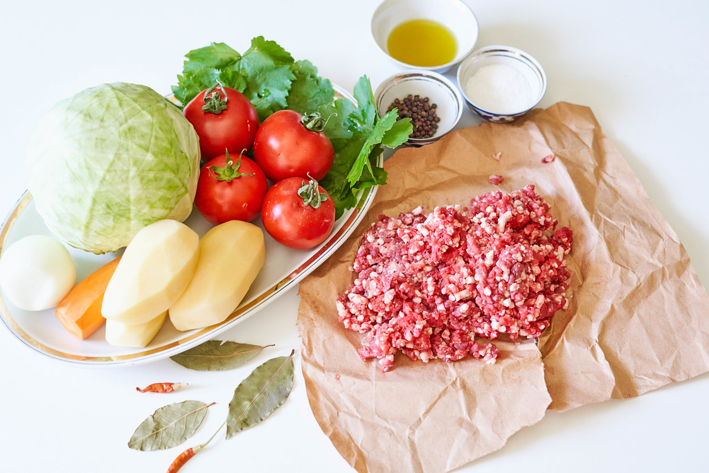 Preparing food with cabbage, minced meat and vegetables