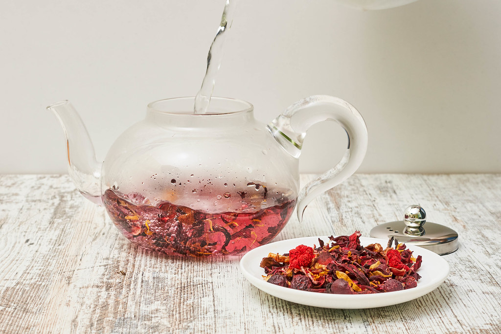 Preparing red tea and dry tea leaves on the plate