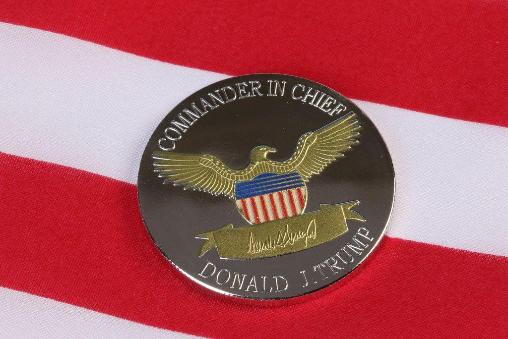 President Donald Trump coin against US flag