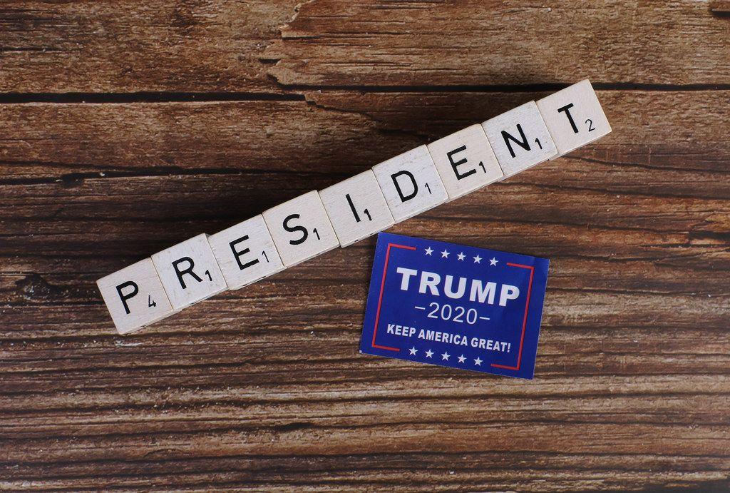 President written on wooden blocks and Trump 2020 campaign sticker