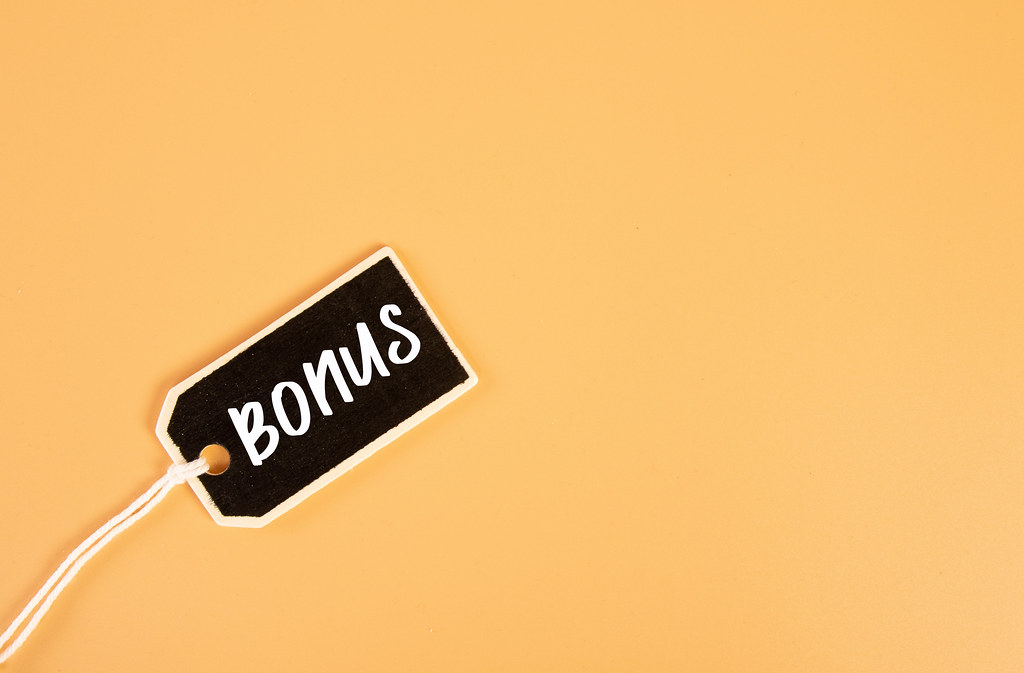 Price tag with Bonus text on orange background