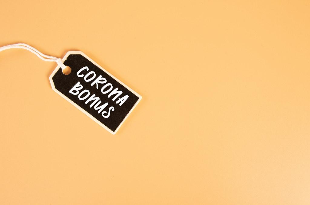 Price tag with Corona Bonus text on orange background