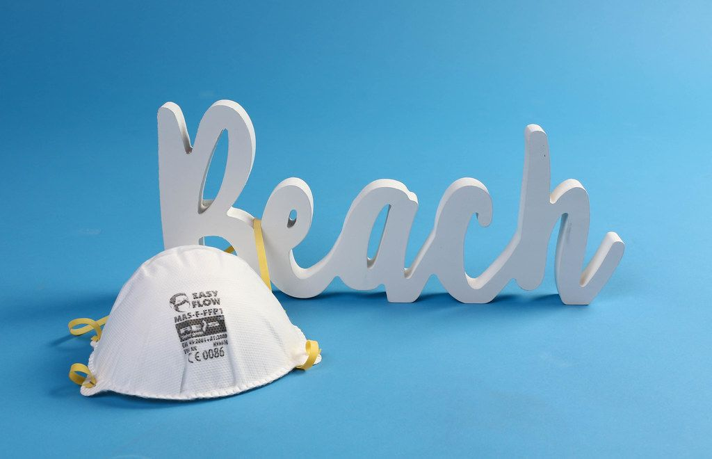 Protective mask Beach text on blue background