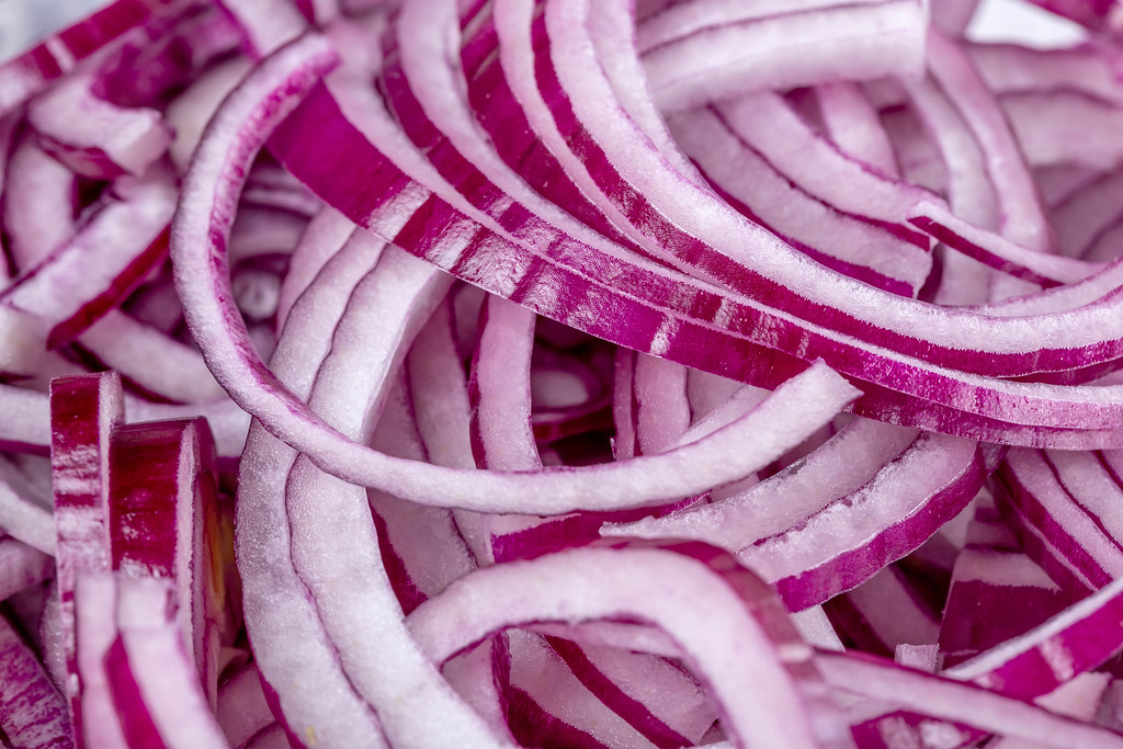 Purple ripe onion sliced, close-up
