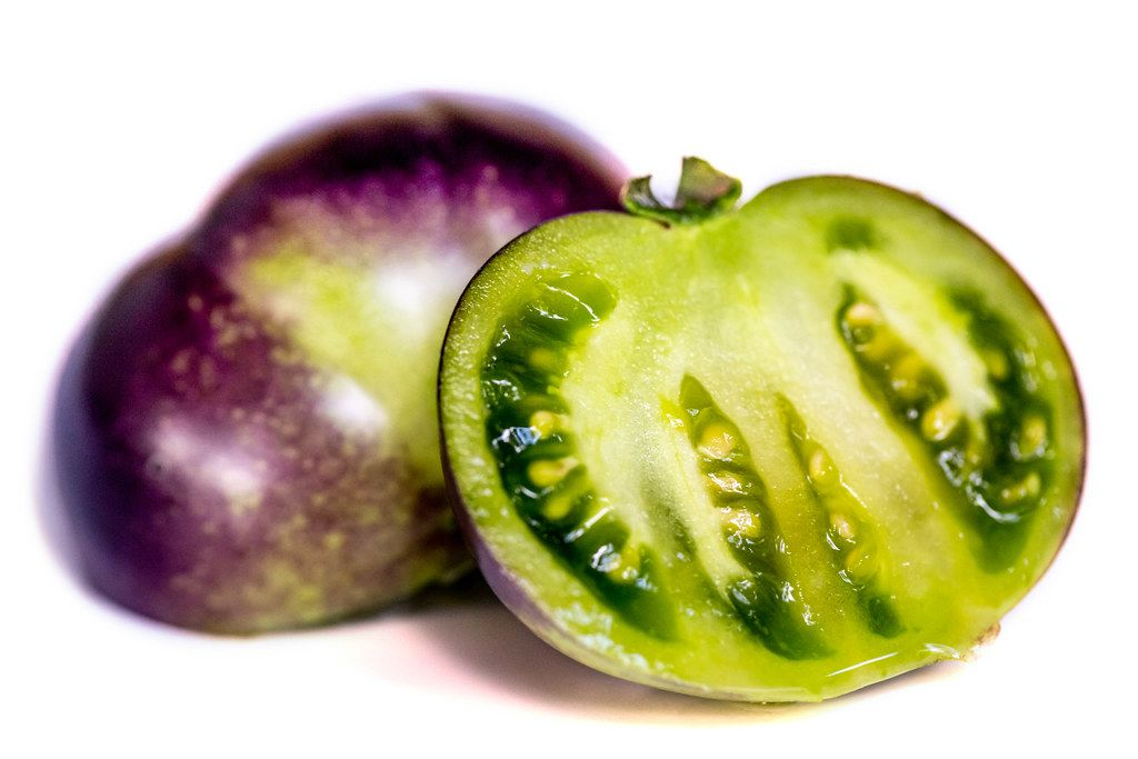 Purple tomato halves with green pulp