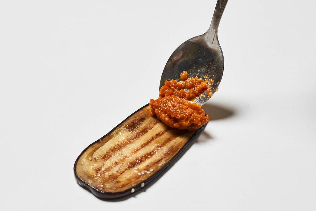 Putting squash caviar on eggplant slice
