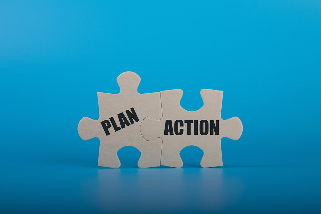 Puzzle pieces with Plan and Action text