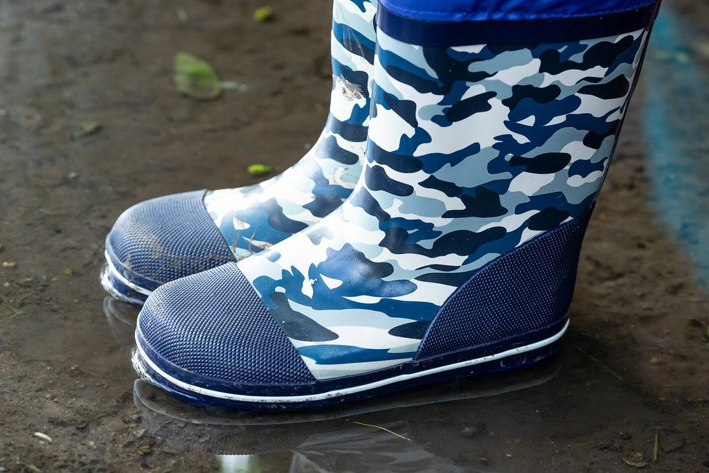 Rain boots for children in a puddle