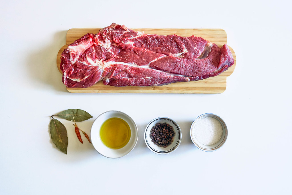 Raw beef steak and spices for cooking